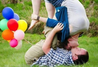 Funny picture of couple smashing faces trying to kiss romantically