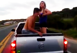 young couple hooking up in the back of a pickup truck