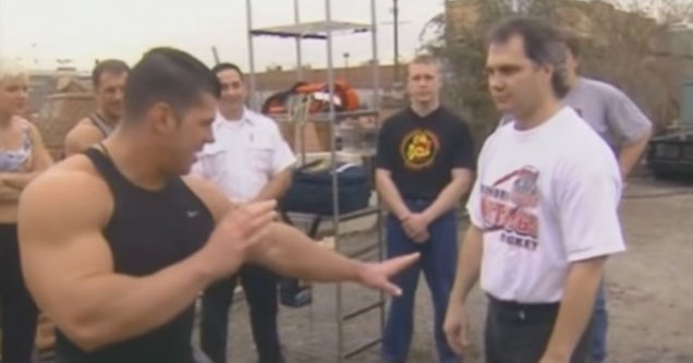 body builders take turns punching a karate master