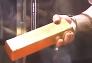 Think You Could Get This 27 Pound Gold Bar Out of This Case?