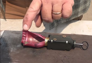Firing A Shotgun Shell Outside Of The Gun