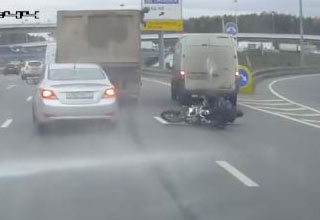 Street Cleaner Sends Biker Into A Hydroplane