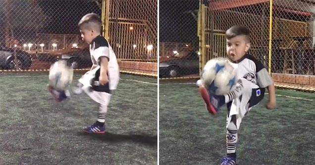little guy juggles soccer ball