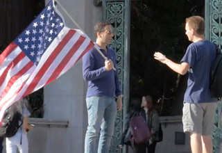 guy with american flag on Berkeley campus