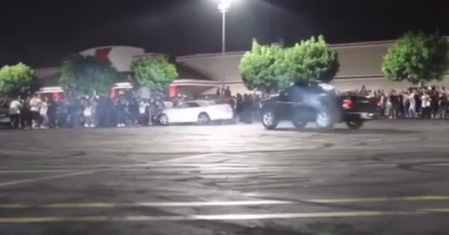 Idiot Mustang Driver Plows Into A  Crowd Of Spectators