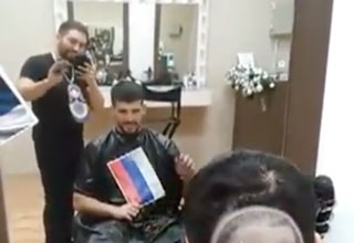 Serbian barber filming a client who asked for a Putin protrait to be shaved into his head