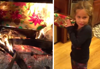 little girl holding a fake christmas present, and then that present burning in a fireplace