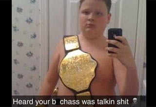 kid wearing wwe championship belt and