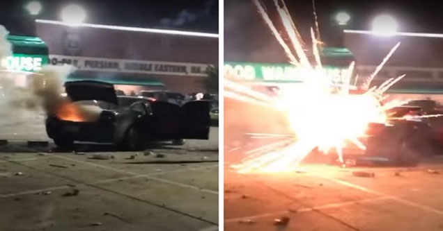 a dark colored dodge charger with the trunk open and multiple fireworks exploding inside the car