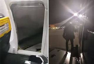 open emergency door and a man standing on the wing of an airplane
