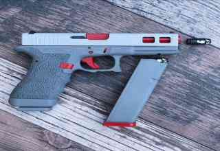 real pistol colored like the gray Nintendo toy gun