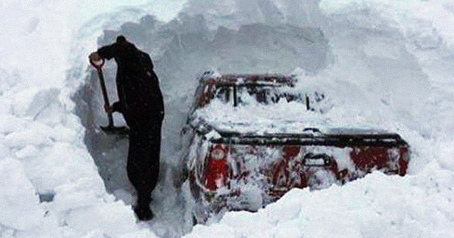 Man shovels truck out of snow