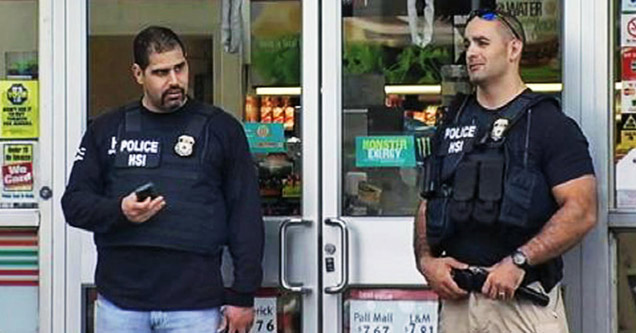 two mean weraing black HSI vests standing in front of a closed 7-11