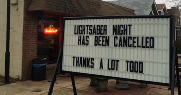 Street sign advertises that lightsaber night has been canceled because of someone named Todd