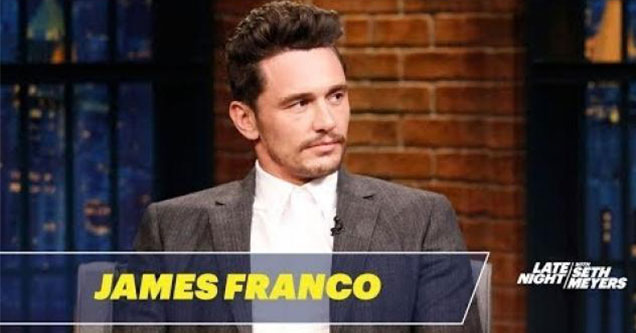 james Franco in a grey suit on the seth meyers show