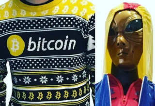 A Bitcoin sweater is adored by a female alien