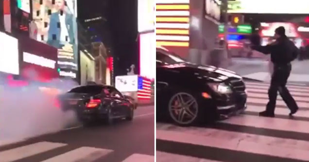 car making smoke in Times Square and a cop trying to stop them
