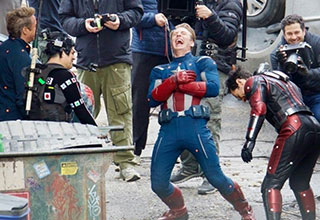 Captain America laughing on the set of the avengers movie