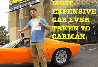guy standing in front of an orange lamborghini miura in front of carmax
