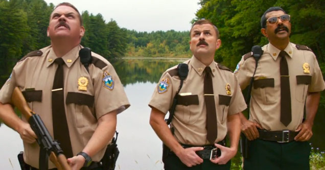 officer farva from super troopers 2 holding a gun