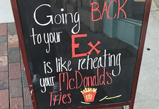 a sign for a bar that reads going back to an ex is like reheating mcdonalds fries