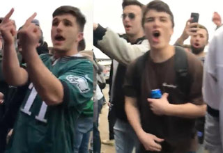a large group of philadelphia eagles fans wearing jerseys and giving the middle finger to vikings fans