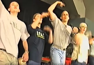 group of guys on stage leading a chant