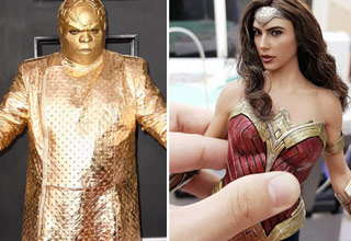 hip hop artist c-low greene in an all gold outfit and gold face paint.  a very realistic figurine of wonder woman played by gal gadot