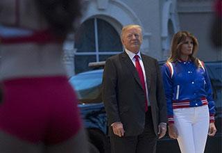 Trump looking longingly at a cheerleader