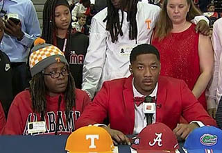 Jacob Copeland sitting next to his mom who looks disturbed