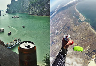 man sky diving with a beer, a beer in front of a bay in vietnam