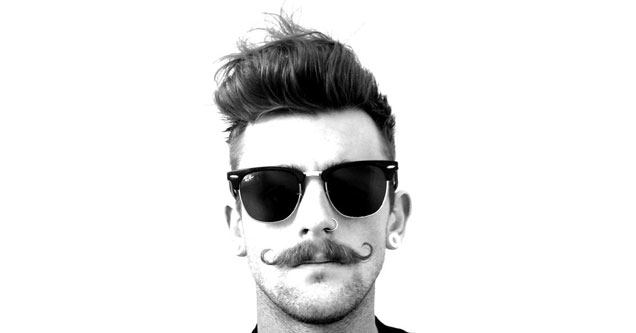 guy wearing sunglasses with a twirly mustache