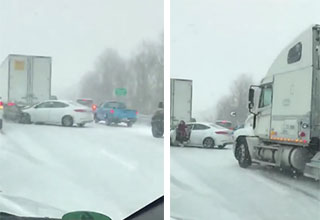 semi truck driving down a snowy freeway and into a car