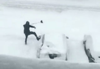 kid kicking snow covered car out of frustration