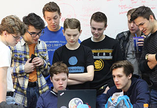 group of nerds looking at a computer