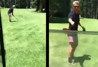 a man playing golf holds his golf club out to stop a golf cart from running him over
