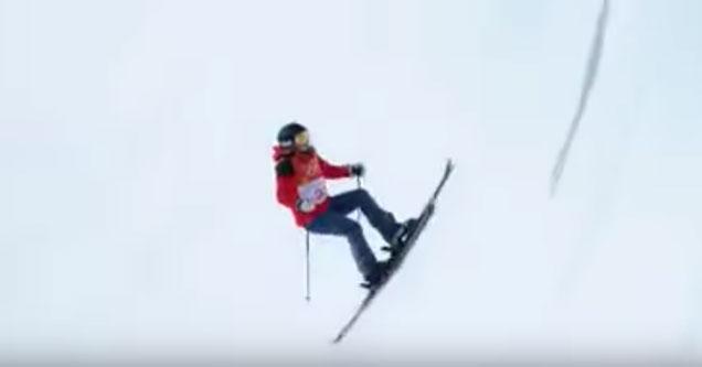 woman skiing through a half pipe