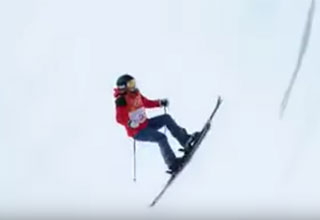 woman skiing through a half pipe