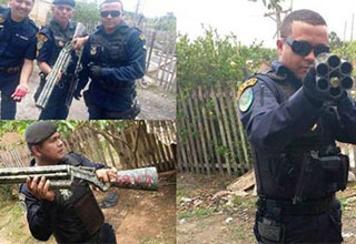 cop holding a giant homemade shotgun