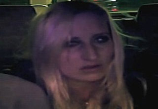 a drunk blonde haired woman sitting in an uber