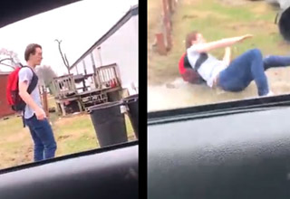 kid in blue jeans and tshirt kicks a trashcan and it knocks him over