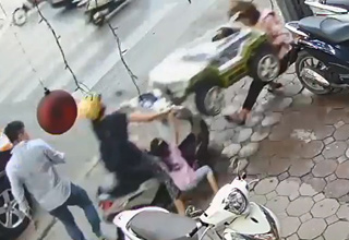 a woman on a scooter with a child in pink clothes crashes into a woman carrying a toy car