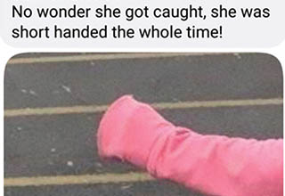 a lady's hand covered in a pink sleeve in a parking lot