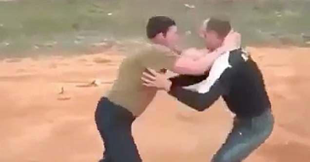 Two guys fight, one headbutts
