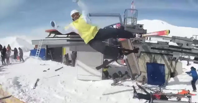 man in yellow jacket comes flying at the camera after being tossed from chair lift