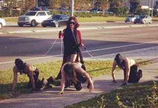 woman walks her three sex slaves