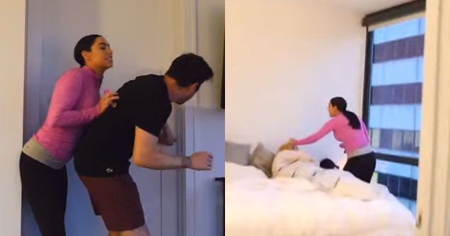 a woman in a pink top pushes her boyfriend and grabs the hair of a woman in her bed