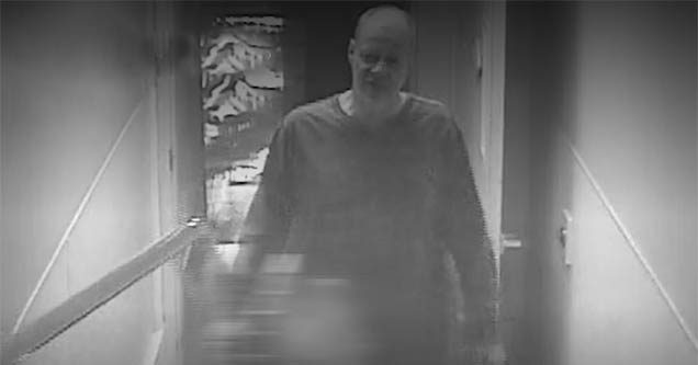 Stephen Paddock Stands in a hotel hallway looking sinister