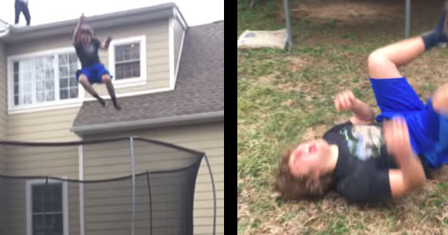 kid in black shirt and blue shorts jumps off 2nd storey roof and hurts himself