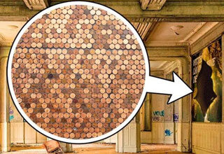 a bunch of pennies in a white circle with an arrow pointing to a hole in the wall